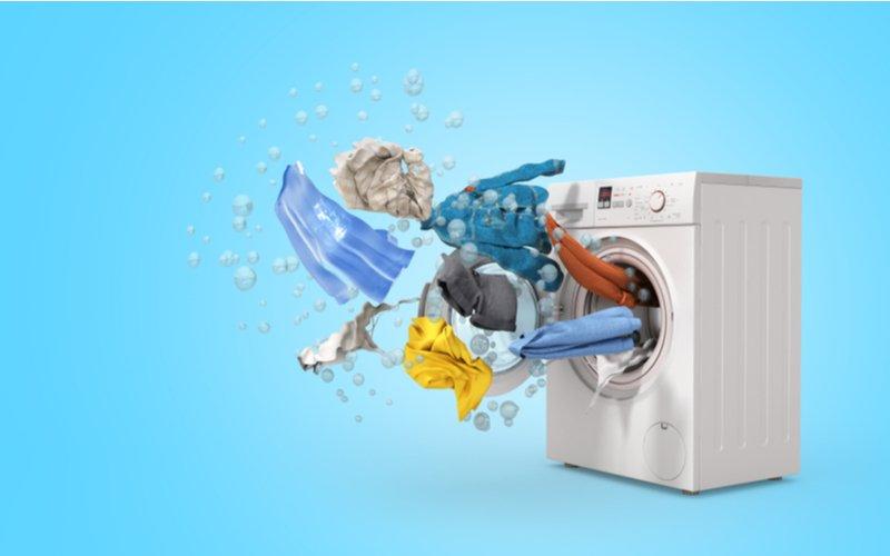 Najlepšie práčky (práčka a lietajúce oblečenie na modrom pozadí)