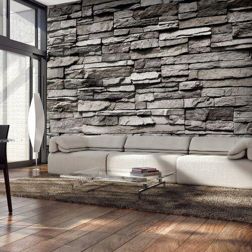 Biela pohovka s kamenným obkladom na stene