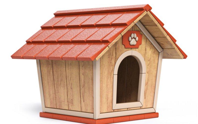 Drevená búda pre psa s červenou strechou