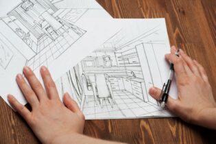 nákresy zariadenia kuchyne na drevenom stole